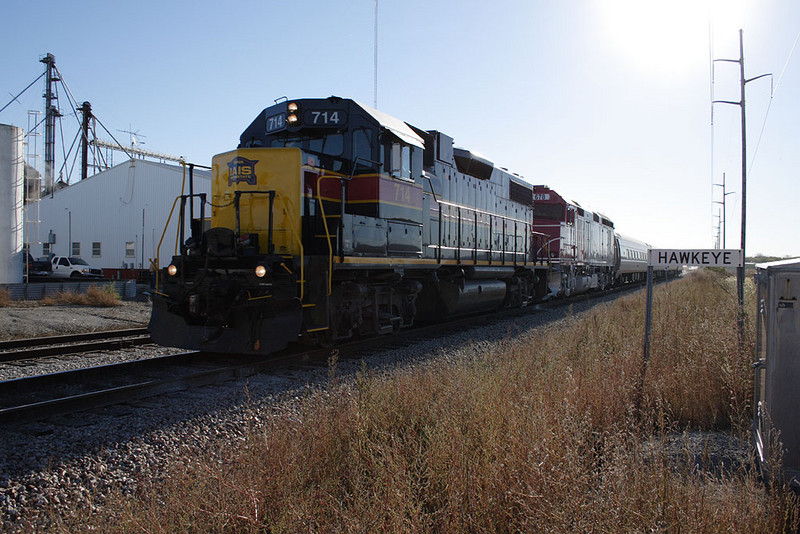 "A special train hosting a trip for the Lexington Group heads west through Hawkeye, IA.  IAIS 714 led IANR 678, 3 Amtrak ""Amfleet"" coaches, and IAIS business car ""Hawkeye.""  14-Oct-2006."