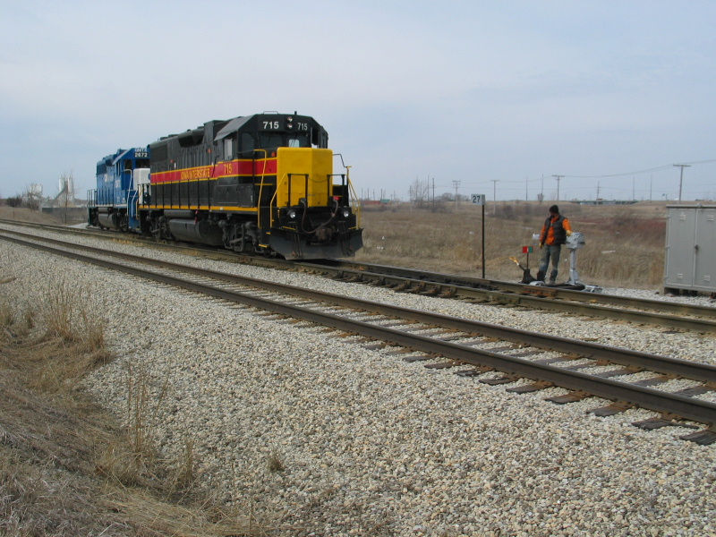 Conductor opens the switch to come back onto the main, Ozinga spur, mp 27, March 25, 2008.