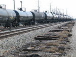 Alcohol loads for NS, out of ADM at Cedar Rapids, going through the crossover and onto the S. Chicago branch at Gresham.