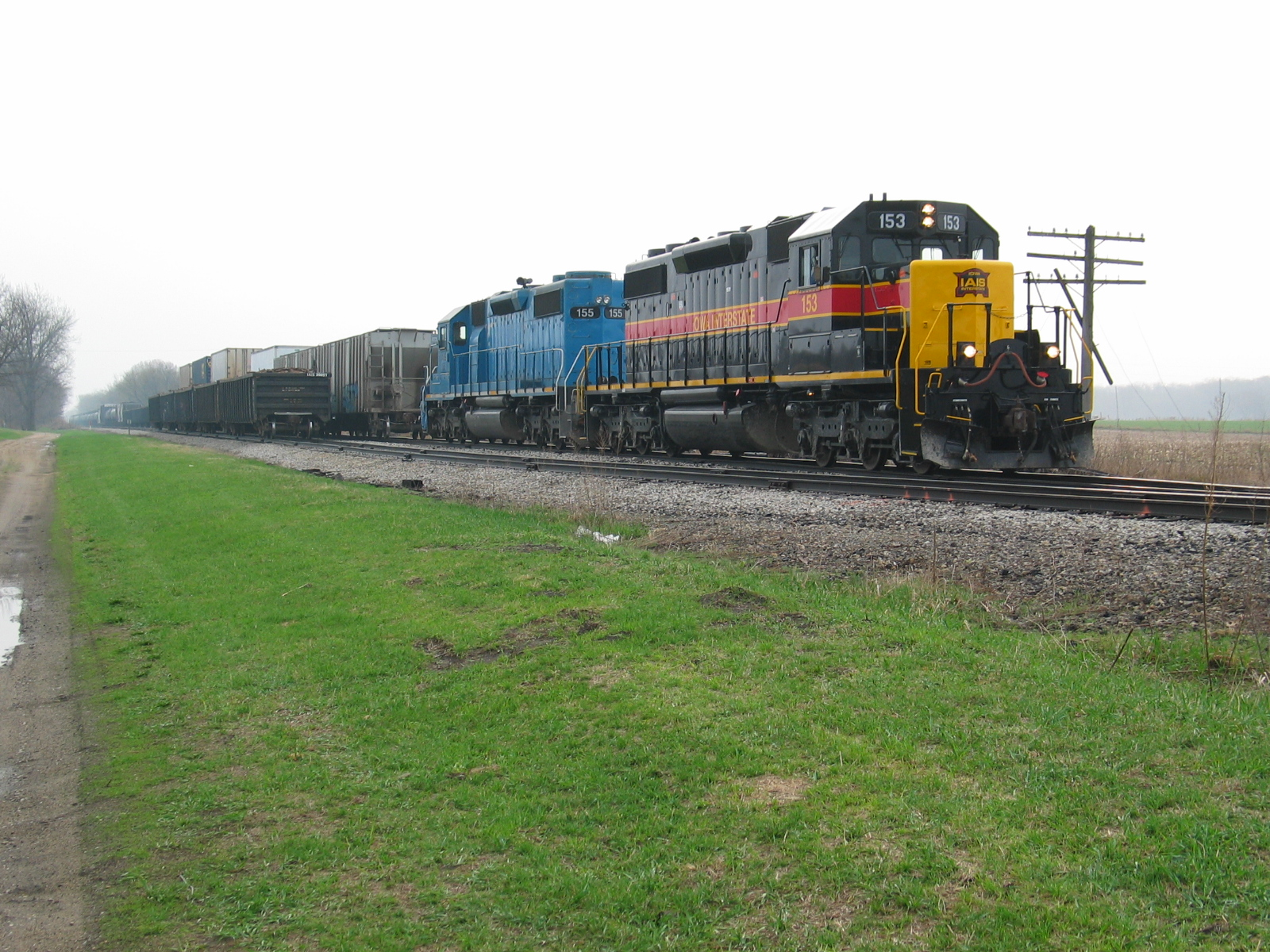 West train at N. Star, March 31, 2007.  The crew has just set out 4 scrap loads and is backing onto their train.