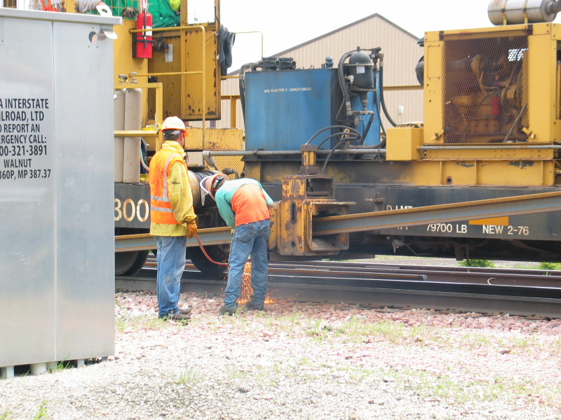 Cutting the rail for the west crossing in Earlham.