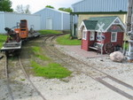 "That's a CNW bay window caboose behind the ""depot."""