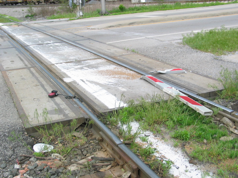 Here are the unfortunate results of a train running over a crossing arm knocked over by a motorist!  At Broadway st. near Blue Island crossing.