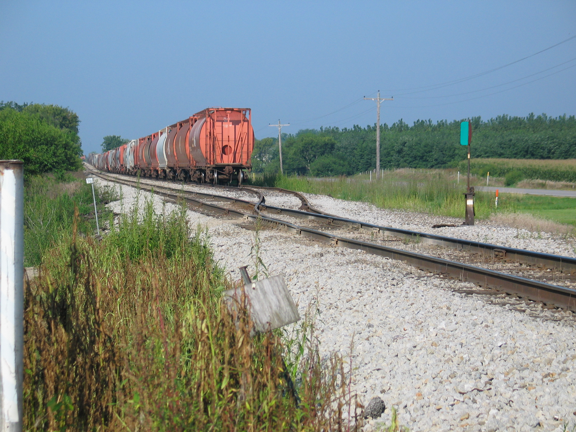 Potash cars stored on the east end of Twin States siding, Aug. 22, 2006.