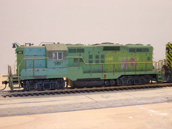 Left side of 303 after completion. Handrails were airbrushed Floquil UP Armour Yellow, then weathered with Grimy Black wash. Near the steps wells, the prototype's handrails are white, yellow, or bare steel, depending on where you look. I've tried to recreate that on the model.