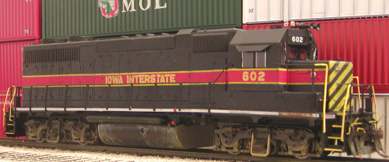 Engineer's side of IAIS 602, an Atlas Early GP38 with shortened Cannon paper air filter, Cannon fans, additional exhaust stacks, and other details added. 602's non-standard IAIS font is from Oddballs Decals IAIS Diesel set. The hanger on the front truck of the prototype appeared to be in primer.