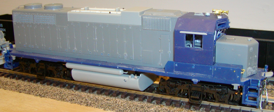 Overall view of IAIS GP38AC 626. This model started out as a factory-decorated CSX unit I received in trade and stripped, which explains the molded blue cab, battery boxes, and walkway.