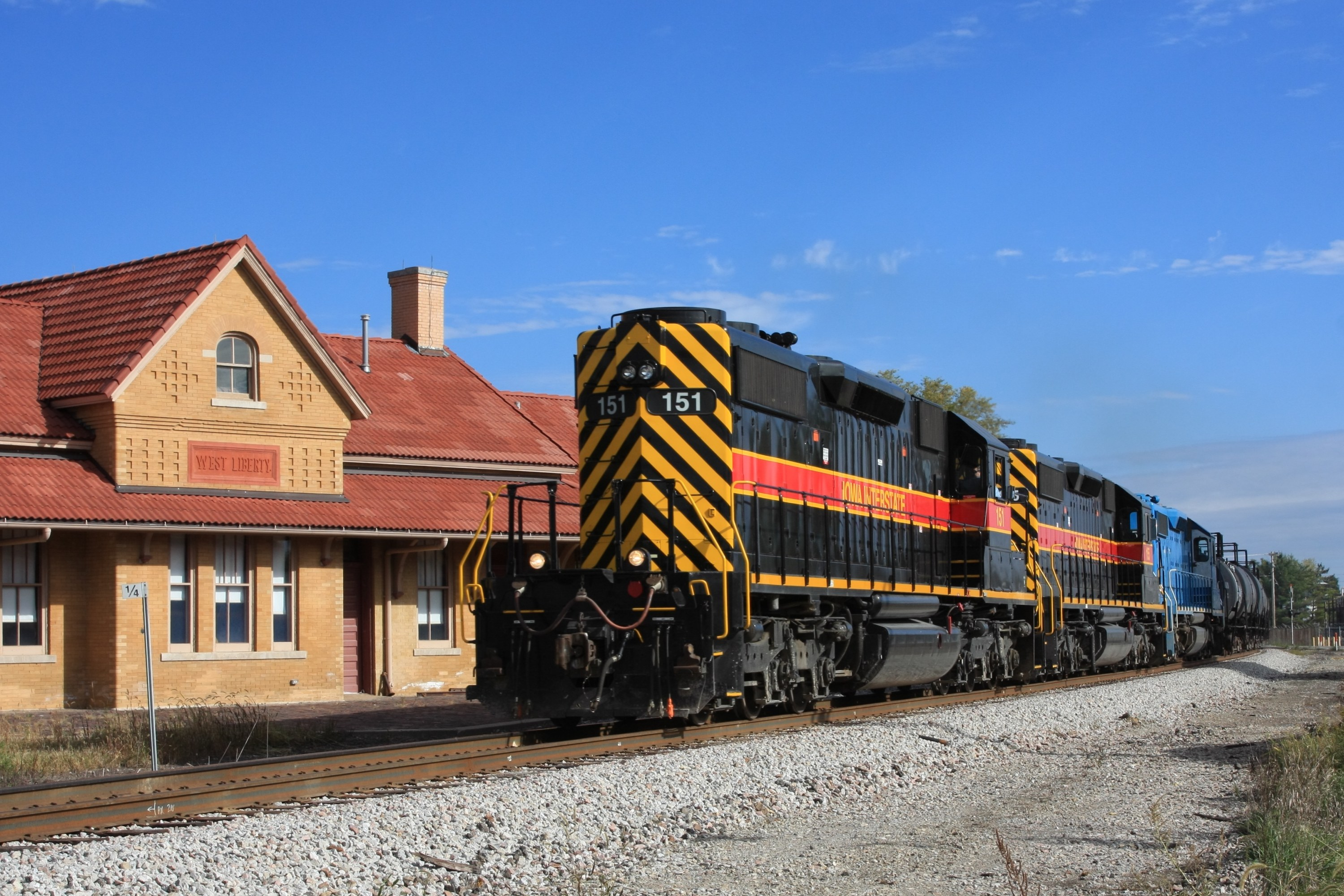 IAIS 151 passing the West Liberty depot