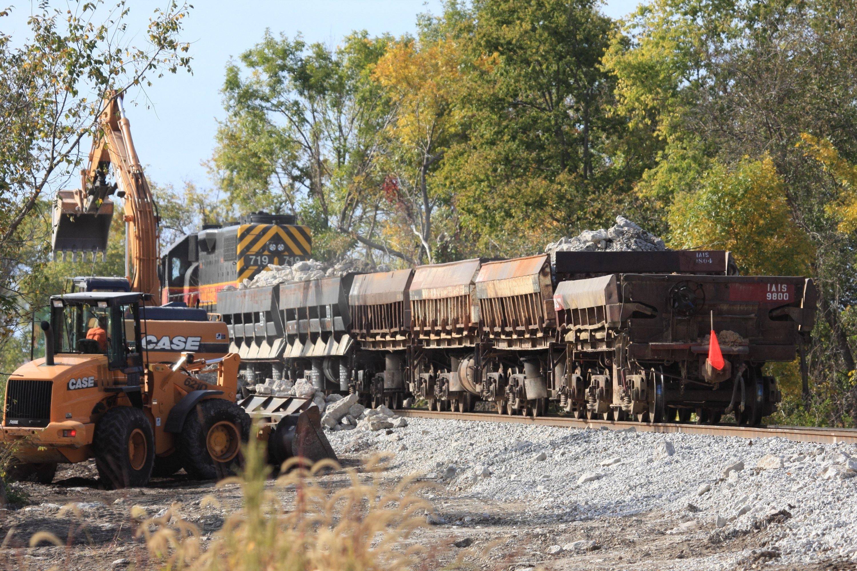 IAIS 719 and work train back out on the main and loading rock near the Wendling Quarry.