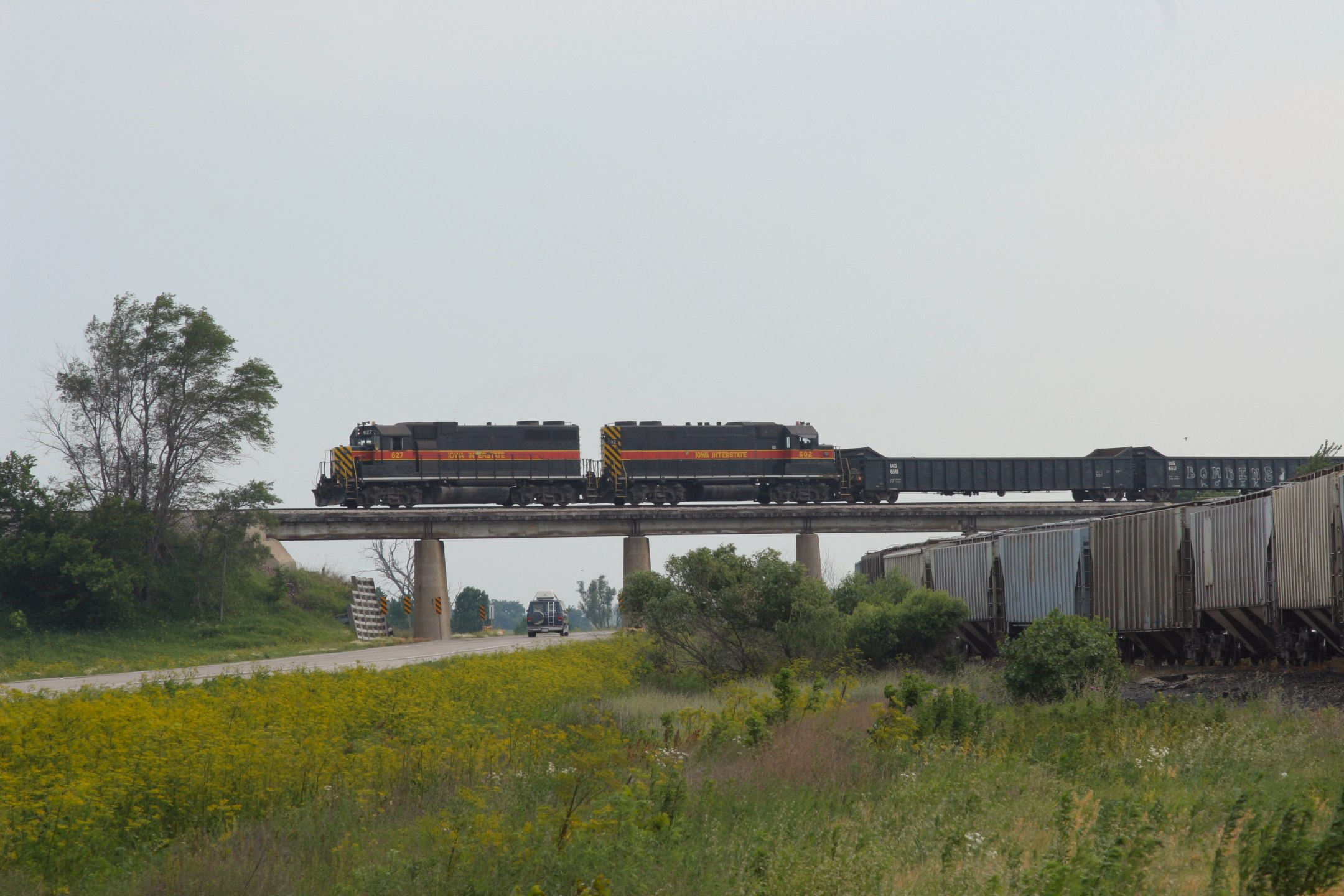 627 and 602 cross the highway at Hancock.  710 and 600 were dropped to drag a cut of hoppers back to Council Bluffs