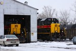 IAIS 156, the other recent SD38-2 addition, sits in the IC squarehouse while 151 idles outside.
