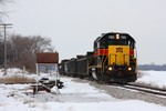 A bit after lunch, IAIS 703 departs Iowa City with the eastbound local, headed for the Gerdau mill at Wilton.