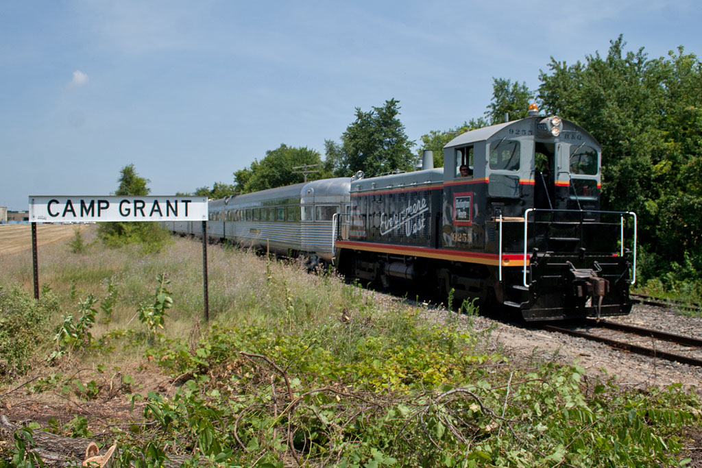 CB&Q 9255 pulls the Nebraska Zephyr south past the BN Camp Grant station sign near the Rockford, IL airport.