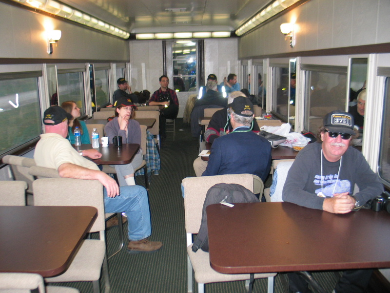 Train riders relax in the Abe.  At right is Chris Guenzler from California, who posted the photo essays that Dave pointed out.