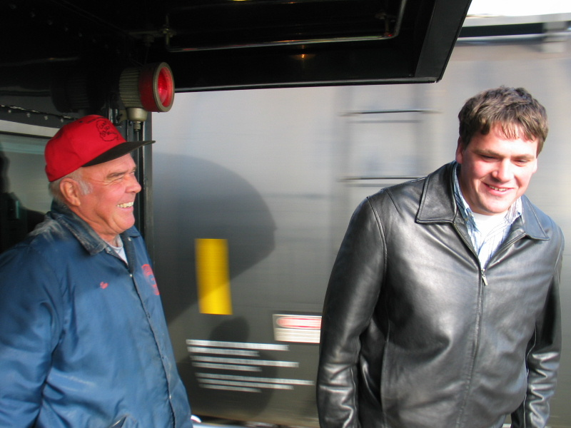 Dad and Greg discuss the merits of syrup tank storage at Twin States.
