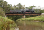 IAIS 7081 is eastbound as it crosses Clear Creek in Coralville, IA on 09-Sept-2006.