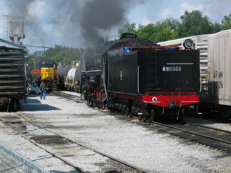 Pulling west on 4 track.  With the turn blocking the siding, the steam engine had to get onto the main at the west end of the yard.  The enginehouse guys moved the 4 geeps (off the morning's inbound turn) out of the way to let the steamer through.  Sept. 7, 2006.