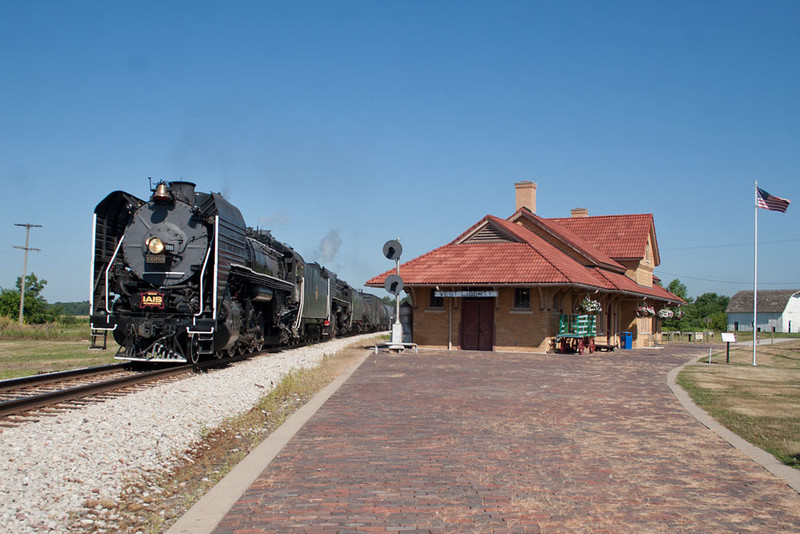 The 7,078 ton double-headed freight pulls past the depot at West Liberty, IA.