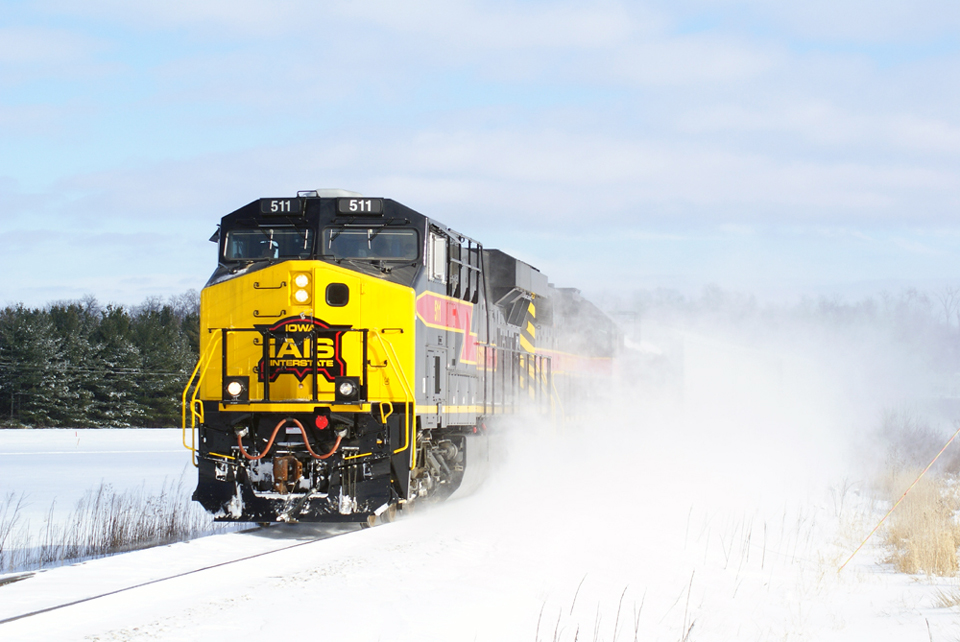511 blows the snow as it crosses Eagle Avenue.