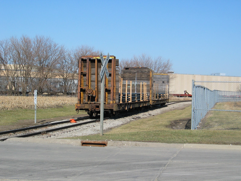 TTPX bulkhead flats waiting to be unloaded on Abassador's spur, Newton.  In the background is the IAIS main, plastic hoppers on the siding, and Maytag plant 2.  Jan. 12, 2006.
