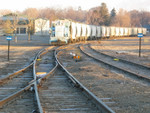Lone Star Cement's GE in their yard at the North end of the Ill. River bridge.  The track to the left goes down the hill to connect with the IAIS.  Feb. 14, 2006.