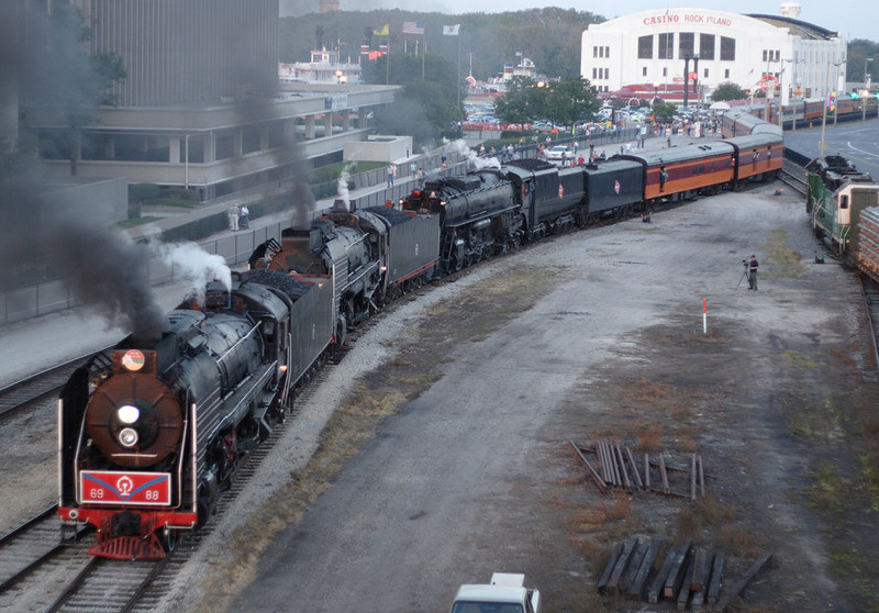 The triple-header arrives in downtown Rock Island, IL.