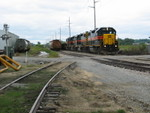 Westbound passes salt hoppers at Hawkeye.