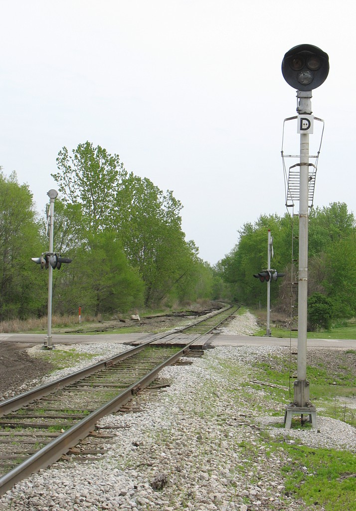 Looking east at Carbon Cliff, IL at the distant signal for the junction at Colona.  April 28, 2006.