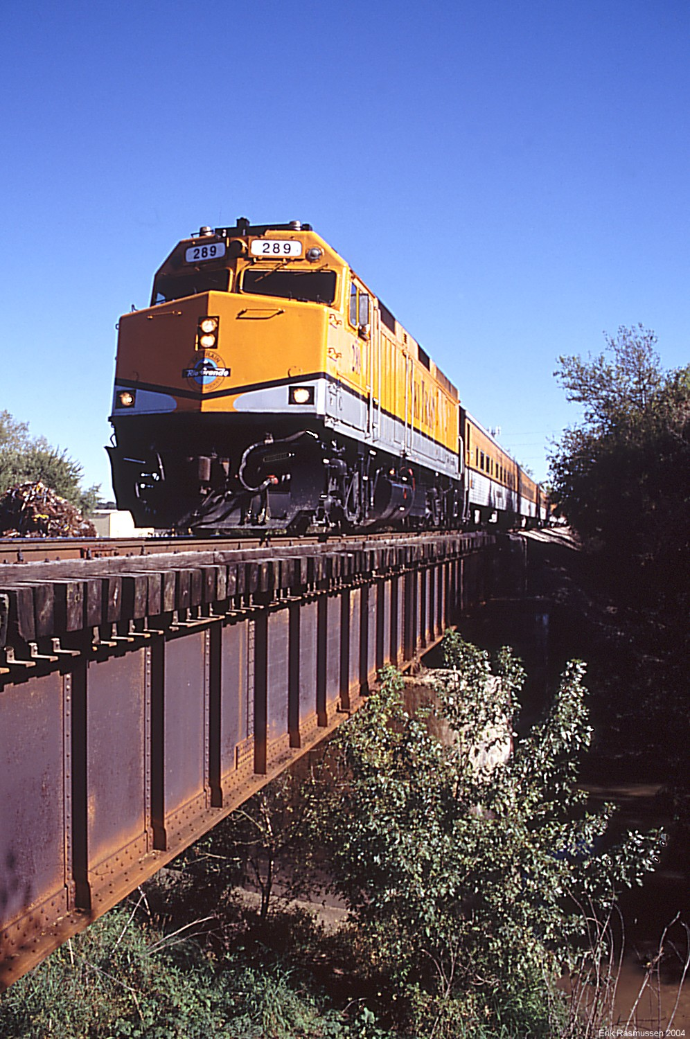 The Ski-Train is making a post-game run of the Hawkeye Express over Clear Creek in Coralville, IA on 10/2/04.