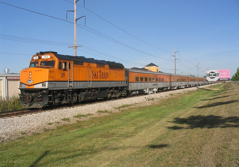 The Hawkeye Express prepares to head west with its 2nd load at Vernon siding in Coralville, IA.  3-September-2005.