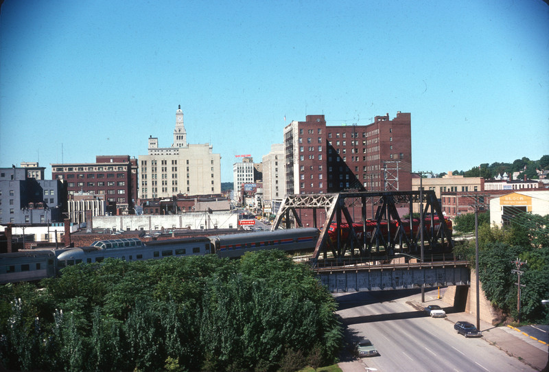 WB Football special crossing 3rd  St. in downtown Davenport.  The overpass in the foreground is the former wye connection to the abandoned 4th St. yard.