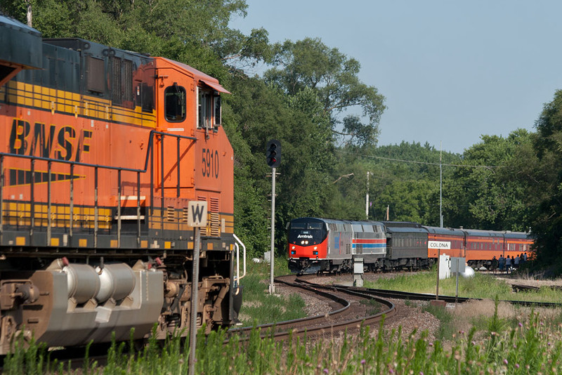 BNSF 5910 has pulled up to the signal and waits for AMTK 156 to enter the IAIS at Colona, IL.