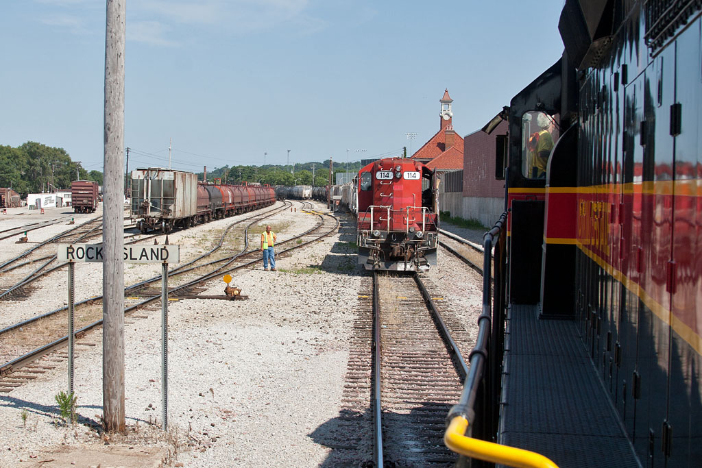 IC&E 114 holds the IAIS main at the west end of Rock Island yard for our train's arrival.