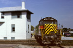"The ""old"" 400 before it's rebuild. Here it is hauling the west train past UD Tower in Joliet, Illinois June 6,1992."