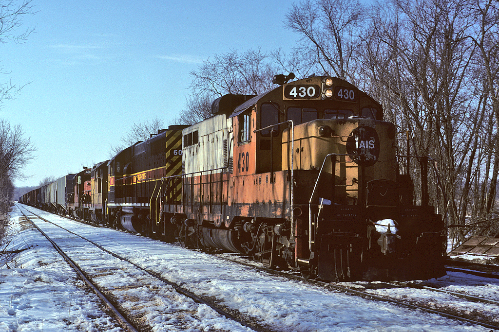 #430 brings an eastbound up to Bureau, Illinois - February 28th, 1993.