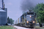 "495 East with ""RISW"" leaves Durant, Iowa May 16, 2003. This train has just swapped cars with the Wilton Turn at Twin States siding, and is returning to Rock Island Yard."