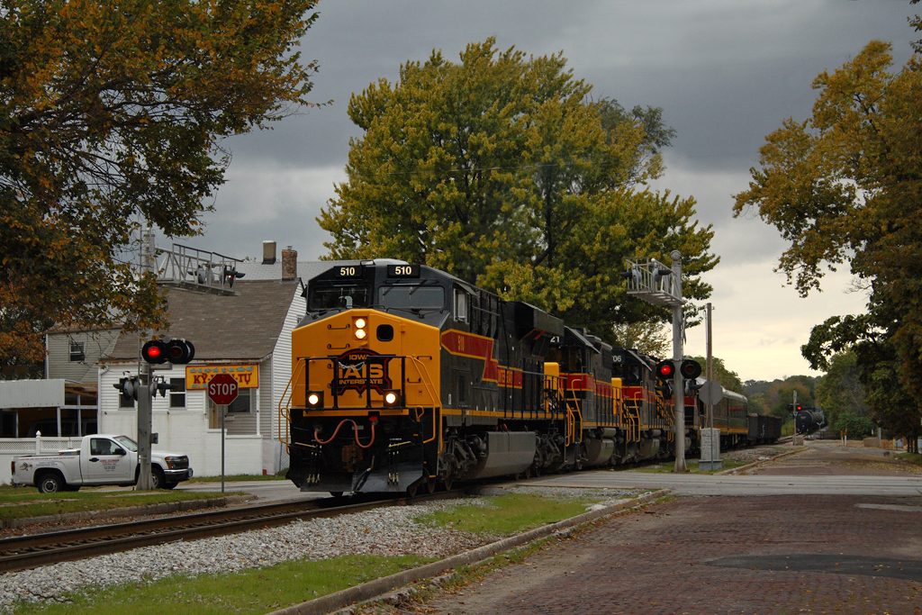 #510 with the East train comes down the hill and switches out the Junction at Taylor Street in Davenport, Iowa. IAIS' business car fleet is in tow for the QJ runs out of Rock Island from October 2008. 10/13/08