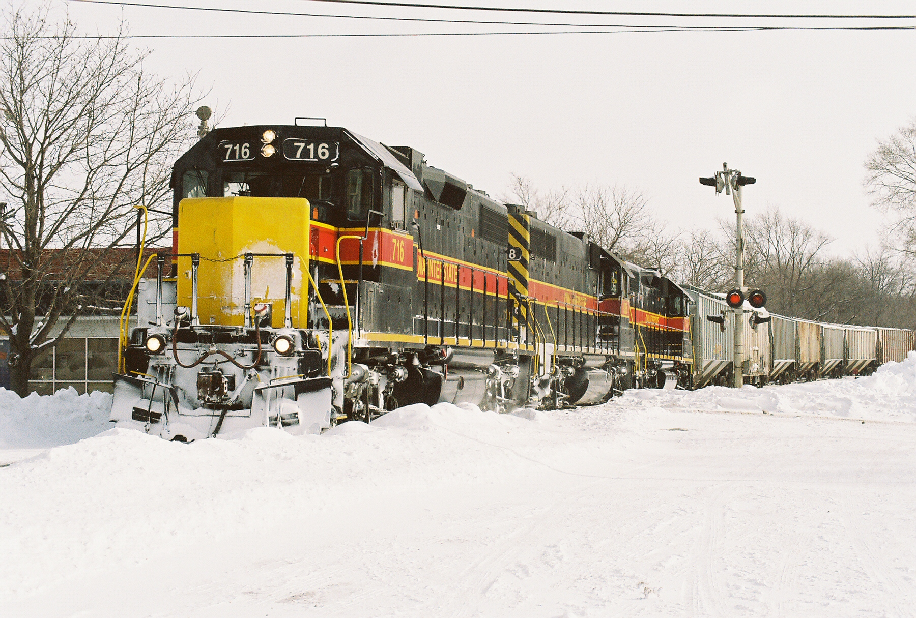 716 (minus it's IAIS emblem) pulls the BICB past the Rock Island depot in Iowa City on a snowy early January 2008 day.