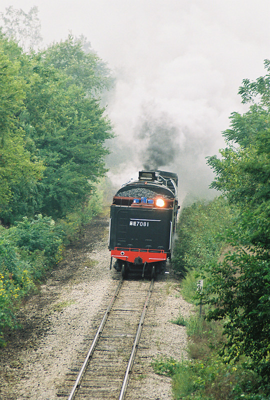 QJ 7081 at Midway Hill running tender first being ferried to the Quad Cities in September of 2006.