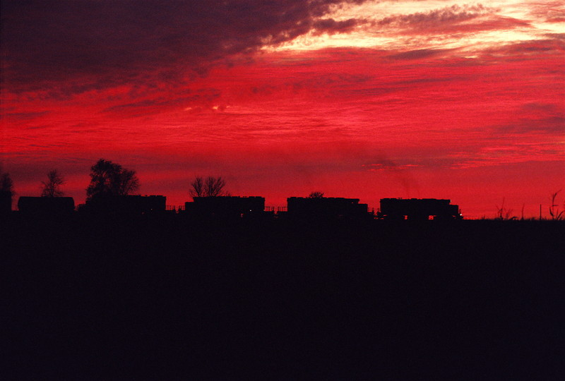 Sunset on the IAIS. A single GP-38-2 and three SD-38-2's take the ICCR train towards Cedar Rapids on October 31st, 2006. It took seven consecutive daily trips to get the Great Gods of photography and trains to cooperate.