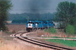4 SD-38-2's in blue pull the CRIC out of Fairfax, Iowa in the spring of 2005.