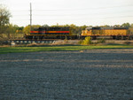 Cedar Rapids job CRIC, east of Fairfax, just after leaving the Crandic yard.  In the background is a UP coal train in their Fairfax yard.  Oct. 17, 2005.