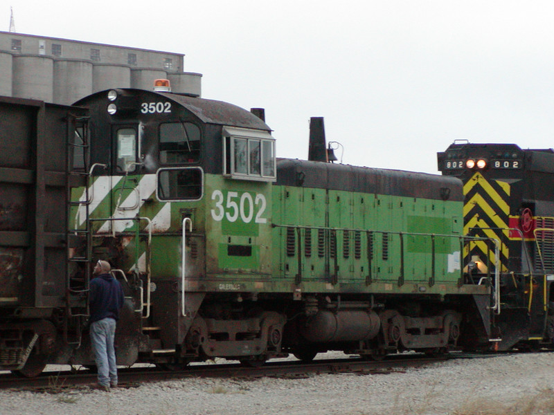 FS 3502, an ex-BN SW1500, makes its way over to the CN interchange on its trip from Silvis to Ida Grove.  Taken 19-Oct-2004