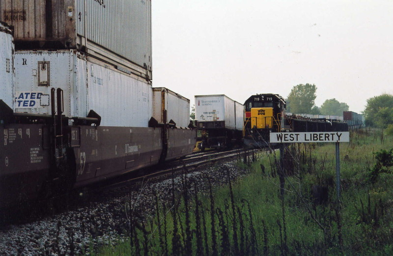 The east train and local are trading cars at West Lib.; the local has just pulled the TIPZ trailers out of the ramp and spotted them to the siding for the EB to pick up, meanwhile the local waits on the main with scrap for Wilton and stacks for the ramp.  Sept. 12, 2005