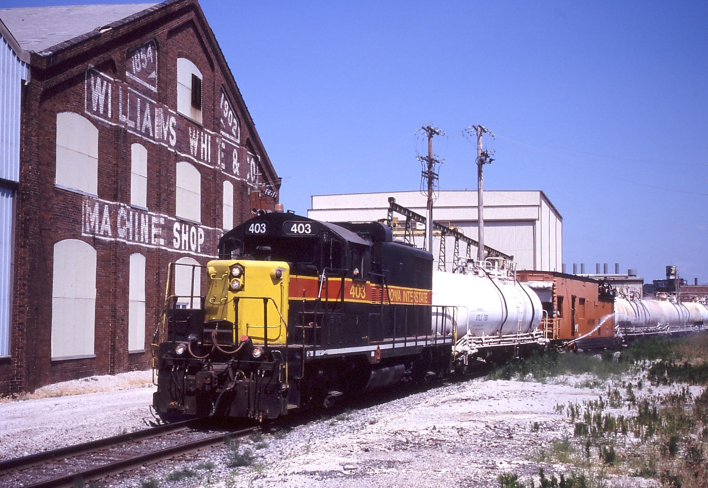 IAIS 403 is seen again passing Williams White Inc in Moline, IL on June 22, 2005.