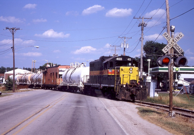 IAIS 403 crosses Andulusia Rd on the Milan Branch in Milan, IL on June 22, 2005.