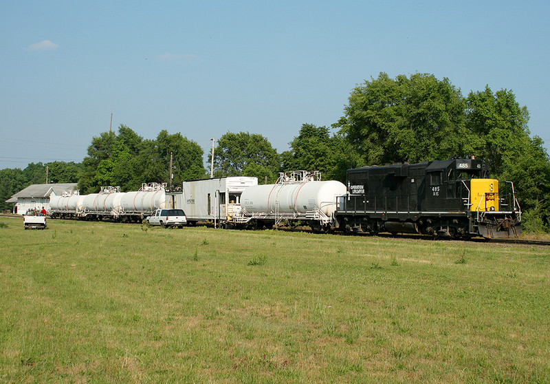 Weed sprayer tied down at Bureau, IL waiting to continue west.  16-Jun-2006.