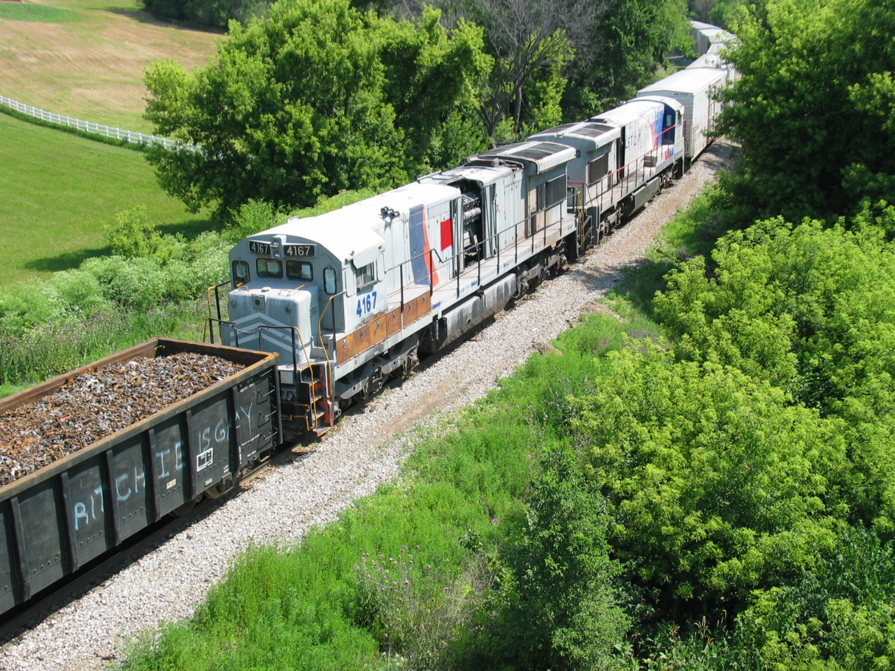 Dead GEs, scrap, and ARMN reefers, getting made up for the eastbound out of Bluffs, June 20, 2006.