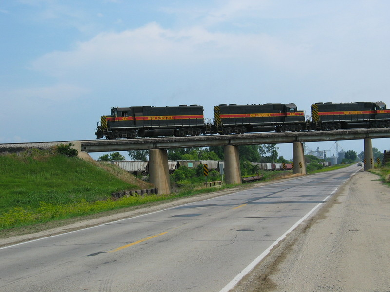 West train on the Hancock overpass, June 21, 2006.  In the background are hoppers parked on the connection track for Hancock elevator.