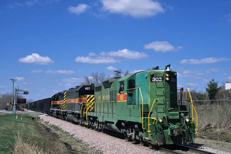 #303 brings the East train in at Davenport, Iowa April 1st, 2004.